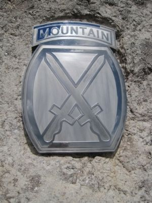 10th Mountain Division symbol on the Soldiers of the Summit Memorial image. Click for full size.