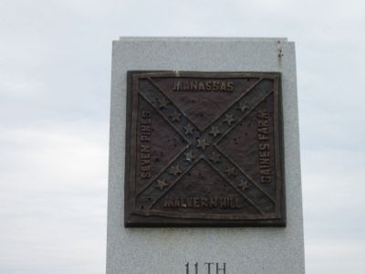 Bronze Flag Atop Monument image. Click for full size.