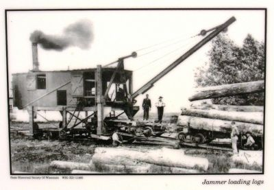 Lower left photo: Jammer loading logs image. Click for full size.
