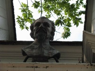 A bust above the main doorway of The Raleigh Tavern. Photo, Click for full size