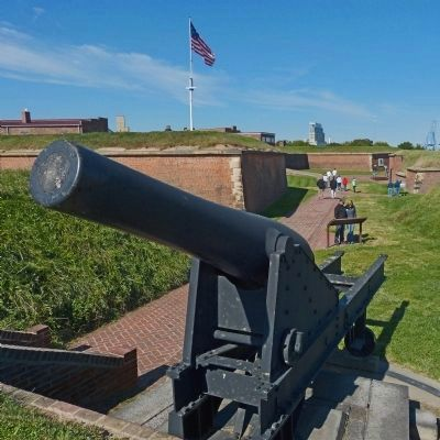 Tourists read the Outer Battery Marker with an 8-inch Roman gun in the foreground image. Click for full size.