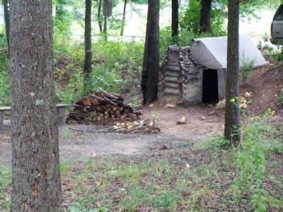 Cabin of Lt. Col. J.B. Leake, nearby reconstructed dugout hut image. Click for full size.