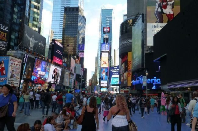 Pedestrian traffic in Duffy Square - view from monument, looking south, image. Click for full size.