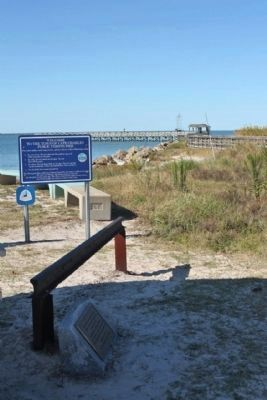 Marker, rail, and the riprap jetty image. Click for full size.