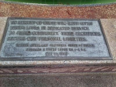 Plaque on the fountain at the DC Area Police Memorial, 1984 image. Click for full size.