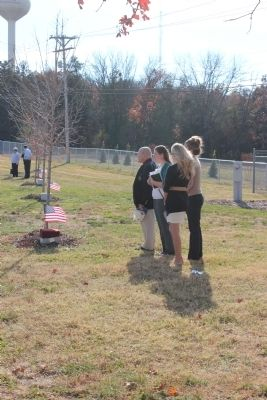 Veteran and student at a recent dedication image. Click for full size.