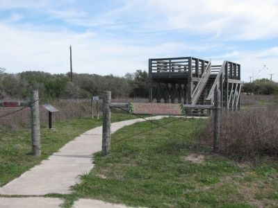 Viewing stand with marker on left and sign on right image. Click for full size.