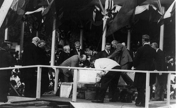 Laying the PAU Building's cornerstone, 1908 image. Click for full size.