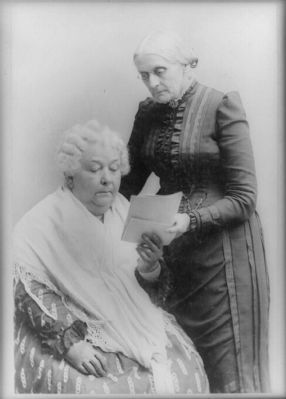 <i>Elizabeth Cady Stanton, seated, and Susan B. Anthony, standing </i> image. Click for full size.