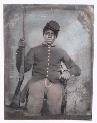 Unidentified African American soldier in Union sergeant uniform holding a rifle image. Click for full size.