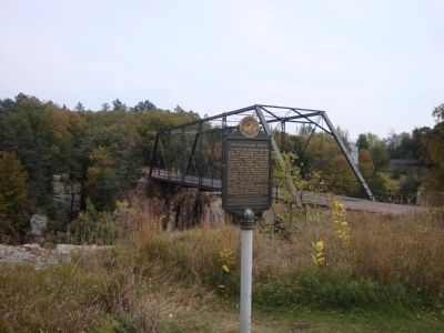 1908 Palisades Bridge Marker with Bridge in Background image. Click for full size.