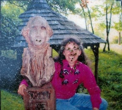 Shelly Upole<br>and her Chainsaw Carving of George Washington image. Click for full size.