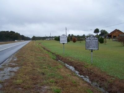 Dred Scott And The Blow Family Marker looking west along US 58 image. Click for full size.