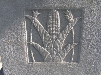 Relief carving of corn on Original Patentees Memorial Marker image. Click for full size.
