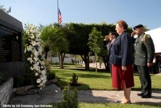 Ambassador Aponte lays a wreath at the marker. image. Click for full size.