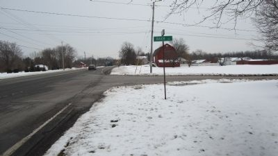 Distant Eastward View of Marker with corner road sign image. Click for full size.