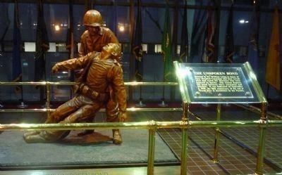 """Unspoken Bond"": statue of a Navy Hospital Corpsman assisting a wounded Marine in the lobby image. Click for full size."
