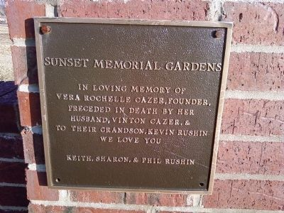 Sunset Memorial Gardens entrance gate plaque image. Click for full size.