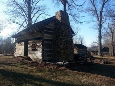 The Living Historical Farm exhibits a typical pioneer cabin. image. Click for full size.