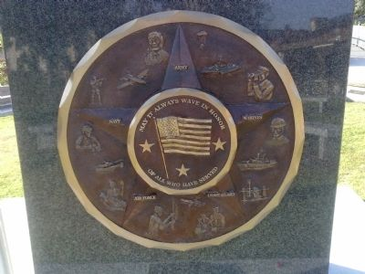 Image of flag on disk honoring the military service branches image. Click for full size.