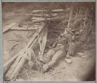 Dead Confederate soldier as he lay on the field, after the battle of the 19th May image. Click for full size.