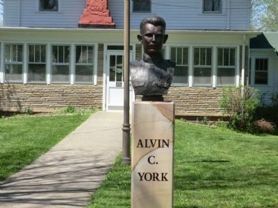 Alvin C York-bust in front of house image. Click for full size.
