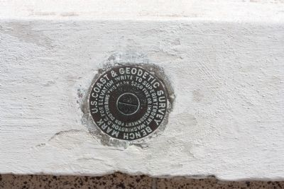 Survey Benchmark emblem located under marker image. Click for full size.
