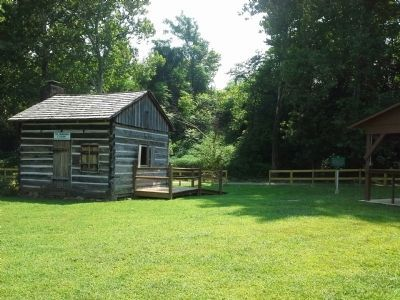Marker in front of fence, with Col. Crawford's Cabin to the left. image. Click for full size.