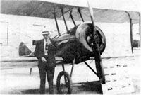 Clarence Wissler with one of his planes image. Click for full size.