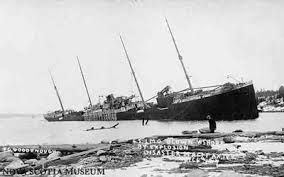 The S.S. Imo blown ashore by the explosion. image. Click for full size.