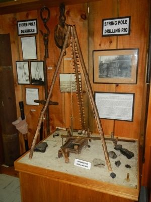 Model of a three-pole, spring-board oil derrick image. Click for full size.