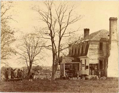 <i>The Moore House, near Yorktown, Va., showing effect of fire from Confederate batteries</i> image. Click for full size.