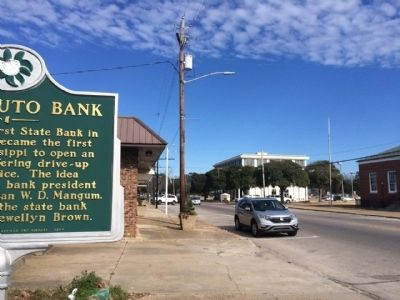 View of marker looking north on Azalea Drive towards First State Bank. image. Click for full size.