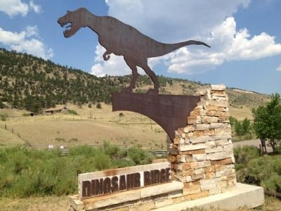 Entrance sign with part of Dinosaur Ridge in background. image. Click for full size.