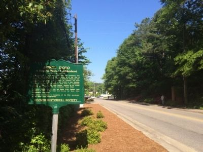 View of marker looking west on Wisteria Drive. image. Click for full size.