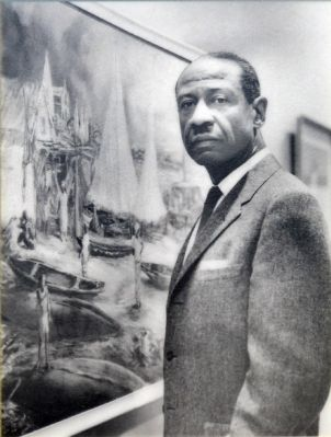 Professor James A. Porter with one of his paintings image. Click for full size.
