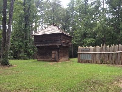 Fort Mims blockhouse and stockade recreation. image. Click for full size.