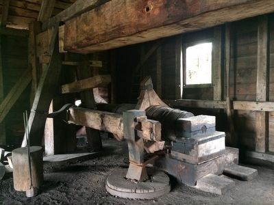 Large water-driven power hammer at the forge. image. Click for full size.