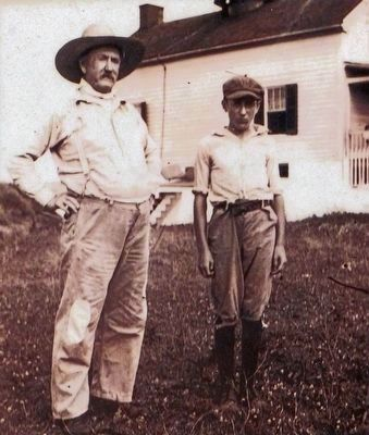 Unidentified Jones Point Lighthouse keeper and boy, circa 1905. image. Click for full size.