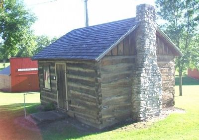 Log Cabin and Marker image. Click for full size.