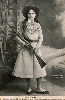 <i>Annie Oakley - famous rifle shot and holder of the Police Gazette championship medal</i> image. Click for full size.