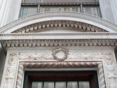 The First National Bank Bldg Entrance Typanum image. Click for full size.