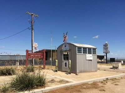 Avenger Field sign and old WASP building. image. Click for full size.