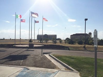 View of marker and flag display in front of Visitors Center. image. Click for full size.