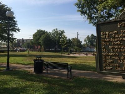 Peace Park includes walking trail and picnic tables. image. Click for full size.
