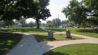 View of a portion of cemetery grave markers. image. Click for full size.
