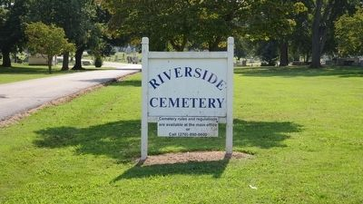 Riverside Cemetery sign nearby. image. Click for full size.