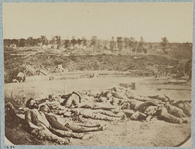 Confederate dead in front of Fort Robinette, Corinth, Mississippi image. Click for full size.