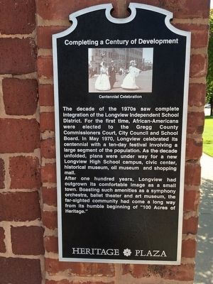 Completing a Century of Development Marker image. Click for full size.