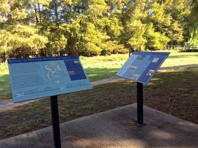 Interpretive markers and old canal area. image. Click for full size.